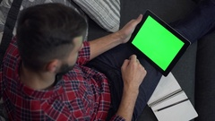 Man Use Tablet PC with Green Screen and Notebook Stock Footage