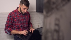 Attractive Young Man Work on Laptop in Kitchen Stock Footage