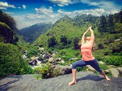 Woman doing Ashtanga Vinyasa Yoga asana Virabhadrasana 1 Warrior Stock Photos
