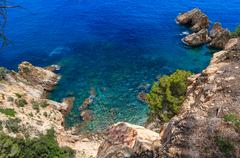 Summer sea rocky coast view (Spain). Stock Photos