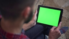 Man Use Tablet PC with Green Screen Stock Footage