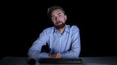 Man feels the emotions of perplexity communicating on the internet Stock Footage