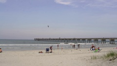 Florida BeachPeople playing the water and walk along the beach in Jacksonville,  Arkistovideo