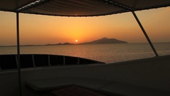 Sunset over Red Sea islands from yacht deck Stock Footage