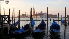 Gondolas in Venice with San Giorgio Maggiore in background. Stock Footage