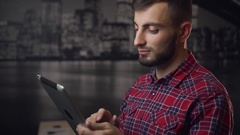 Young Attractive Lumbersexual Man Use Tablet PC Stock Footage