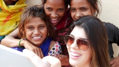 Tourist taking selfie with cute Indian girls Stock Footage