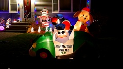 4K Christmas holiday inflatables, front yard house display Stock Footage