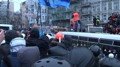 Kiev. Maidan. Huge crowd of protesters pushing the bus at a police barrier Stock Footage