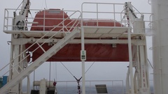 Life boat on the ship, waves of stormy sea, rolling UHD 2997 105mbps Stock Footage