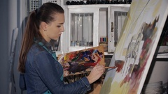 The artist works on a painting Stock Footage