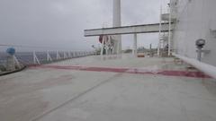 Port side of large ship, rolling, windy, salt on lens WA tilt UHD 2997 105mbp Stock Footage