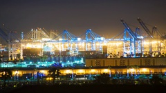 Timelapse of Cranes Loading Container Ship at Port of LA at Night -Zoom in- Stock Footage