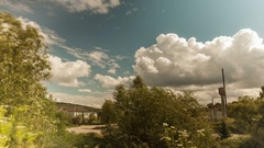 Timelapse in the village, flying clouds, old village school. Stock Footage