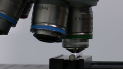 A lens of a microscope Stock Footage