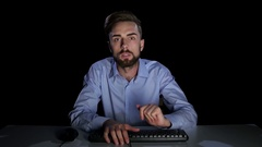 Businessman emotionally excited front of the monitor computer. Dark studio Stock Footage