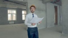 Builder, construstor examines new building. Businessman in suit inspecting Stock Footage