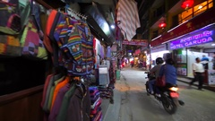 Warm clothes for climbers at street market, evening Thamel. Kathmandu Stock Footage
