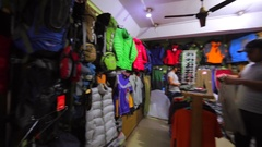 Store with warm clothes for climbers and evening street of Thamel. Kathmandu Stock Footage