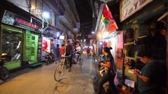 View of driving rickshaw with two passengers. Kathmandu, Nepal. Evening street Stock Footage