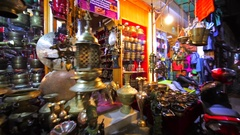 Store with many amazing bronze souvenirs in Thamel. Kathmandu, Nepal. Evening Stock Footage