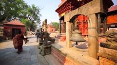 Pashupatinath Temple, Kathmandu, Nepal. Tourists ring bell and touch statues. Stock Footage