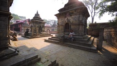 The Pashupatinath Temple. Man does breathing exercises. Kathmandu, Nepal Stock Footage