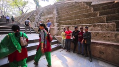 Teenagers play game on the staircase in the Pashupatinath Temple. Kathmandu Stock Footage
