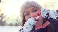 Winter girl showing heart sign. Joyful teenage model girl having fun in winter p Stock Footage