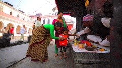 Hindu monk blesses little girl in the Pashupatinath Temple, Kathmandu. Nepal Stock Footage
