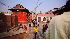 View of square in Pashupatinath Temple, Kathmandu. Hindu monk blesses girl Stock Footage