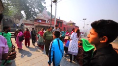 Tourists cross the bridge across Bagmati river. Pashupatinath Temple, Kathmandu Stock Footage