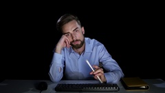 Businessman with indifference looking at a computer screen. Dark studio Stock Footage