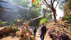 Ascending on staircase leading to hermit's caves. Pashupatinath Temple, Nepal Stock Footage