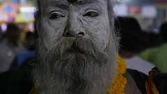 Hindu sadhu holy man at night in Varanasi, India Stock Footage