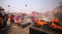 Women perform ritual with fire at Upanayana ceremony. Pashupatinath Temple.Nepal Stock Footage