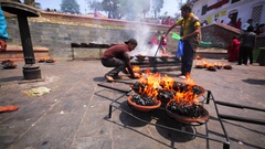 Cups of fire that were brought from the Pashupatinath Temple. Kathmandu, Nepal Stock Footage