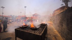 Cups of fire brought for Upanayana ceremony. Pashupatinath Temple. Kathmandu Stock Footage
