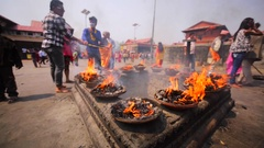 Man performs ritual with fire at Upanayana ceremony. Pashupatinath Temple. Nepal Stock Footage