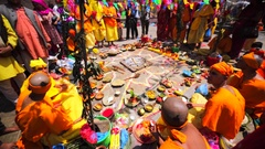 Teenagers sit in front of food at Upanayana ceremony. Pashupatinath Temple,Nepal Stock Footage