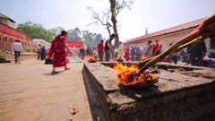 Cup of fire that was brought from the Pashupatinath Temple. Kathmandu, Nepal Stock Footage