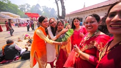 Nepali women look into the camera and smile. Pashupatinath Temple, Kathmandu Stock Footage