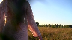 Beauty girl walking on field, raising hands and spinning Stock Footage