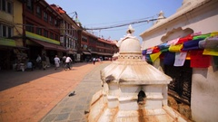 Walking along prayer flags of the Boudhanath stupa. Prayer wheel. Kathmandu Stock Footage