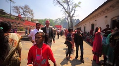 Crowded square in Pashupatinath Temple. Cups of fire and peoplenear them. Nepal Stock Footage