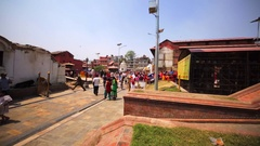 Pashupatinath Temple Complex with tourists. Entering small temple. Kathmandu Stock Footage