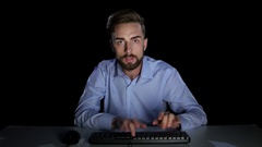 Man with a excitedly looking at a computer monitor. Studio Stock Footage