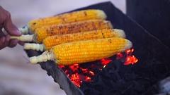 Roast corn. Chef cooking corn in a Jimbaran beach. Truck with roast corn. Stock Footage