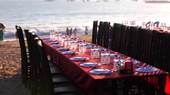 Balinese Jimbaran beach restaurant. Restaurant tables and chairs. Tourists Stock Footage