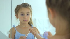 Girl paints the lip gloss in the mirror Stock Footage